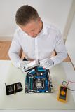 Man Connecting Harddisk With The Motherboard Royalty Free Stock Photos