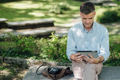 Man connecting with a tablet Royalty Free Stock Photography