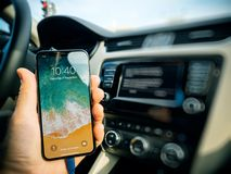 Free Man Connecting To Apple CArPlay The New Iphone X 10 By Apple Stock Photos - 107026753