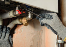 Man connects the gas boiler Stock Images