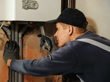 Man connects the gas boiler Royalty Free Stock Image