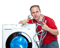 The man connects the washing machine Royalty Free Stock Photography