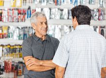 Man Conserving With Son In Hardware Store Stock Photos
