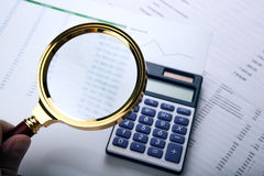 Man considers the budget through a magnifying glass Royalty Free Stock Image