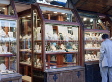The man considers jewelry in a show-window on Ponte Vecchio. Royalty Free Stock Photos