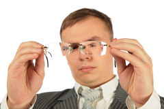 Man considers spectacles glasses Royalty Free Stock Photos