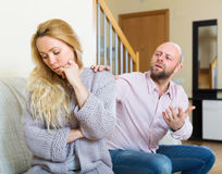 Man consoling the depressed woman Stock Photos
