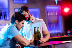 Man consoling his depressed friend Stock Images