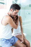 Man consoling wife while looking at pregnancy kit Royalty Free Stock Images