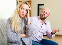 Man consoling woman. Man asking for forgiveness from long-haired woman Royalty Free Stock Photography