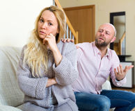 Man consoling woman. Man asking for forgiveness from young woman royalty free stock image