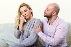 Man consoling woman Royalty Free Stock Image