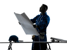 Man construction Architect silhouette. One caucasian man construction Architect working plans silhouette in studio on white background stock photography