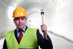 Man with construction hat portrait. And a hammer Royalty Free Stock Photography