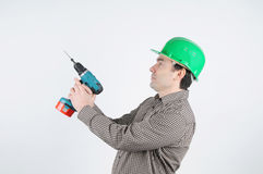 A man in a construction helmet Stock Images