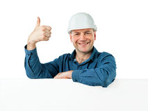 Man in a construction helmet shows gesture OK Royalty Free Stock Photography