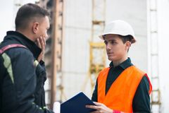 Man a construction project to engineer. Business modern background. Man shows a construction project to engineer. Business modern background royalty free stock photos