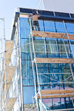 Man on construction ramp. In a new office building Stock Photo