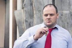 Man at construction site smoking a cigar Stock Image
