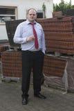 Man at construction site smoking a cigar Stock Images