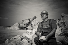 Man in Construction Suit Holding Stone Grayscale Photography Stock Photos