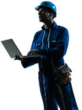 Man construction worker computer silhouette Royalty Free Stock Photo