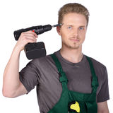 Man construction worker with electric screwdriver Stock Images