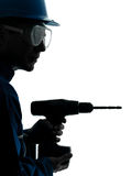 Man construction worker holding drill silhouette Royalty Free Stock Image