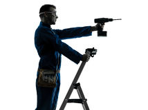 Man construction worker holding drill silhouette Royalty Free Stock Photos