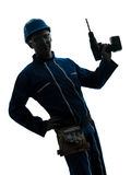 Man construction worker holding drill silhouette Stock Image