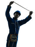 Man construction worker holding Tape Measure silhouette Stock Photo