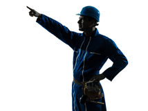 Man construction worker pointing showing silhouette portrait Royalty Free Stock Images