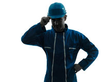 Man construction worker saluting silhouette portrait Royalty Free Stock Image