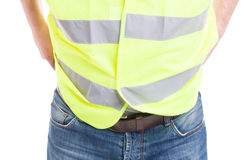 Man constructor in blue jeans wearing reflective safety vest. In close-up isolated on white studio background Royalty Free Stock Photo