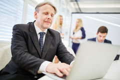 Man consultant with laptop Stock Image