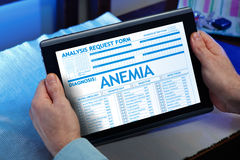 Man consulting on internet your medical record with anemia diagn Royalty Free Stock Images