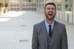 Man with contagious laughter.  royalty free stock images