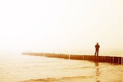 Man contemplates sunrise. Conceptual image Stock Photography