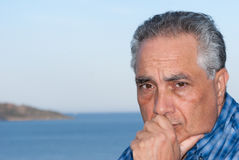 Man contemplating. Man thinking and contemplating with his hand on his face Royalty Free Stock Images