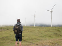 Man contemplating wind turbines in nature Royalty Free Stock Photos