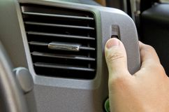 Man control automobile air conditioning. Stock Image