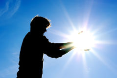 Man control the sun Royalty Free Stock Image