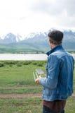 Man controling a drone. Man controling a drone on mountain background Stock Image