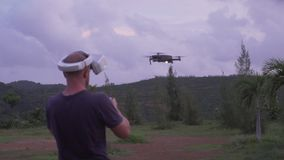 Man controlling drone outdoors