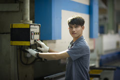 Man controlling hydraulic Press brake Stock Images