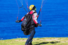 Man controlling parachute on windy day Stock Photography