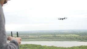 Man controlling a quadrocopter drone