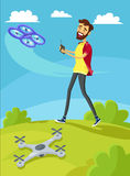 Man Controls the Drone on Lawn Royalty Free Stock Photography