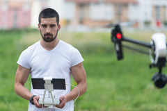Man Controls Drone in Nature Royalty Free Stock Photos