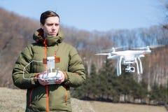 Man controls the drone in open terrain Stock Image
